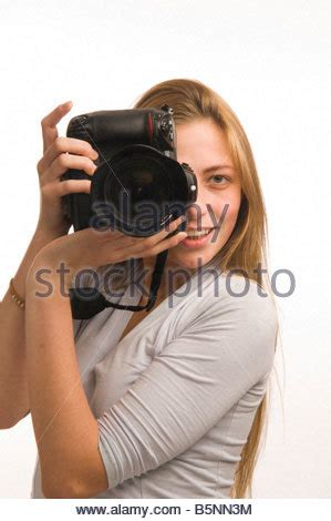 woman taking a photo with a dslr digital camera