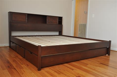 Wooden Bed Frames With Storage Drawers Brown Teak Bed Frame With Three Storage Drawers On Brown Wooden Laminate Floor Of