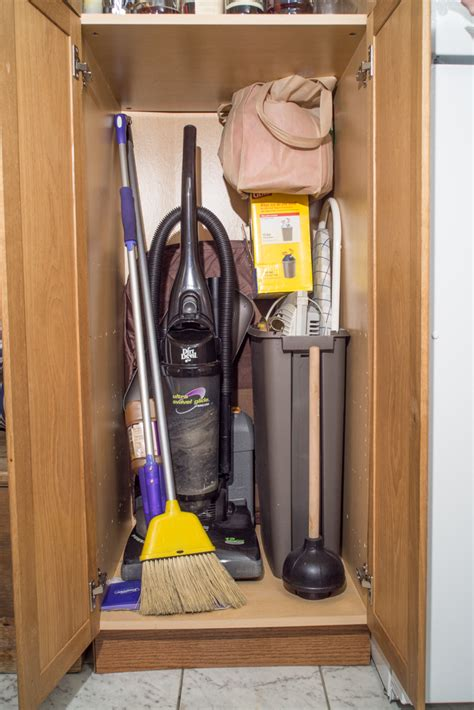broom storage cabinet wood the simple broom closet cement patio