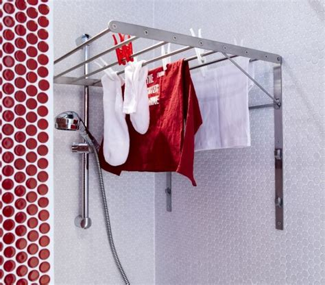 ikea folding clothes drying rack turn your shower into a laundry room with the grundtal folding drying rack it simply folds down