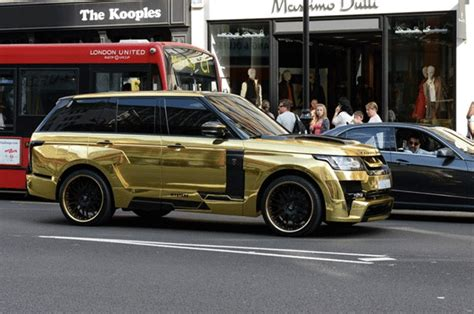 black and gold range rover tourist drives his gold range rover as rich arabs flock to