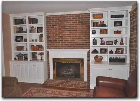 cabinets surround a fireplace traditional family room