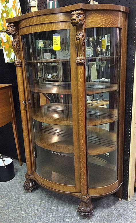 oak curio cabinets with curved glass oak curved glass curio cabinet with claw and lions