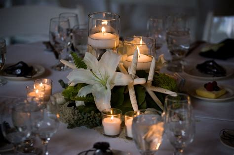 table centerpieces candle and arrangement on grey table cloth for