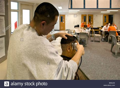 haircut for in prison haircut for in prison haircut a hispanic inmate gets a haircut in the dayroom of a cell