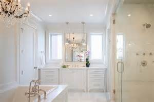 master bathroom white all white master bathroom with chandelier over tub