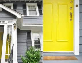this grey house with yellow door home decor