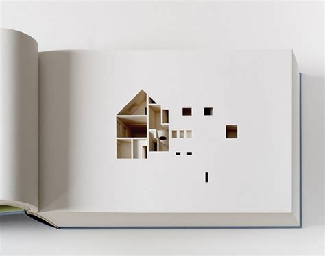 the negative space of a house cut inside a 908 page book