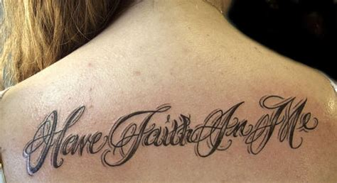tattoo lettering upper back have faith in me lettering tattoo on women upper back
