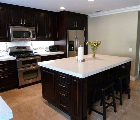 Floors And Decor Dallas love the look of the white countertops with the dark