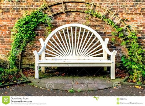 park bench seat white park bench seat against old brick wall stock photo image 50917296