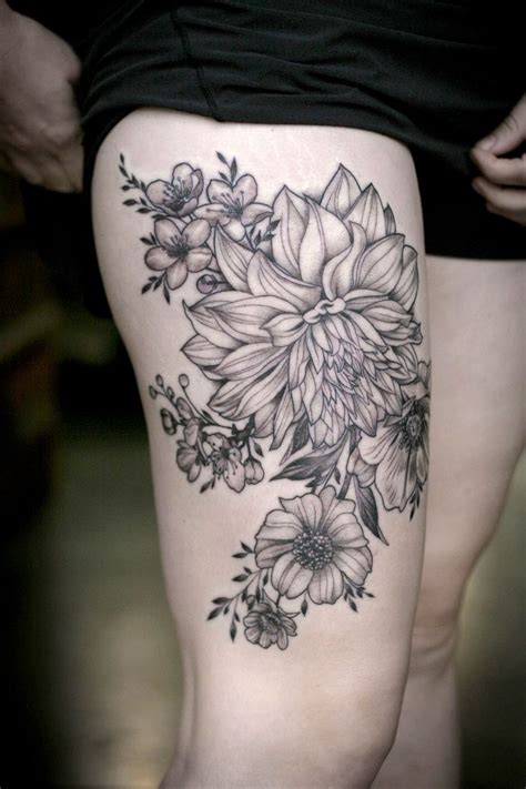 black flower tattoo black lines dahlias and garden flowers on hip by