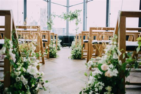 Wedding Aisle Lined With Flowers by Knot Pop Wedding Planners