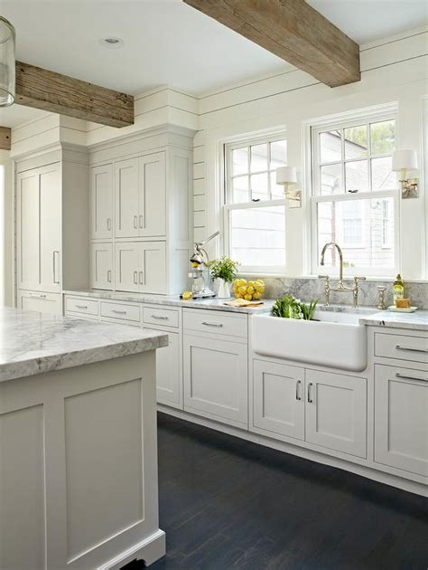 white rustic kitchen cabinets light gray kitchen with rustic wood ceiling beams