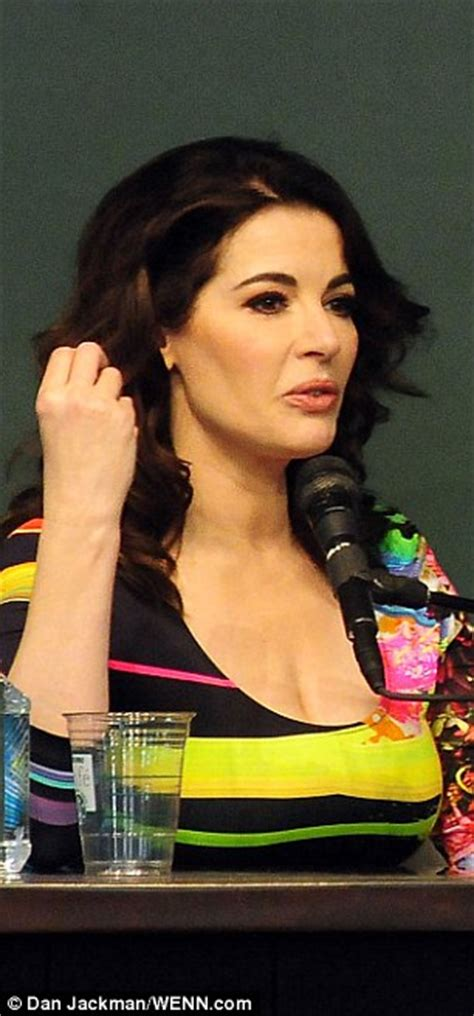 Hair Style Books Sold At by Nigella Lawson Stands Out In Multicoloured Skintight Dress