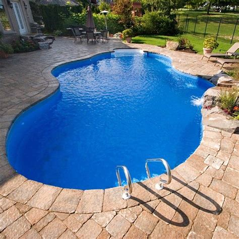 deep backyard pool the deep blue liners pop with a grey red stone inground