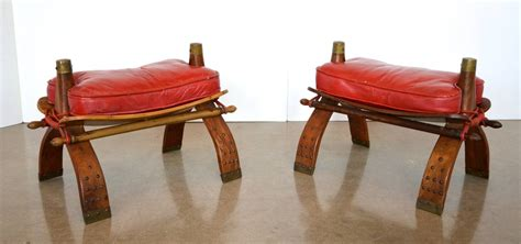 camel saddle ottoman camel saddle stools or ottomans in red leather at 1stdibs