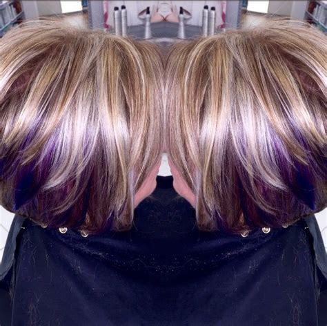 dirty blonde bob hairstyle with peek a boo highlights blonde hair with brown highlights and purple peek a boos