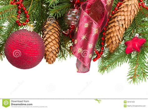fir tree with red christmas decorations and cones stock