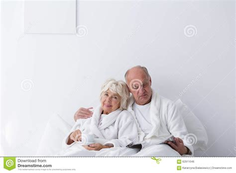 romantic couple images in bedroom romantic couple in bed images elderly romantic couple in bedroom stock photo image