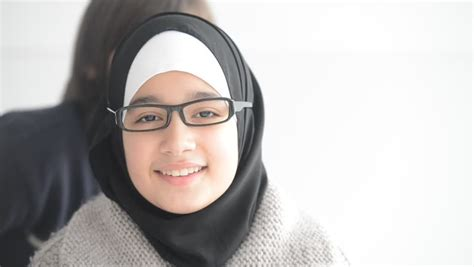 arabic video clip cute teenager arabic girl wearing glasses smiling stock