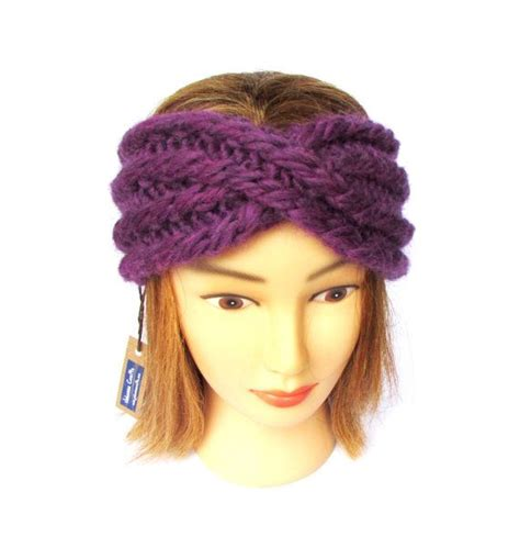 how to knit a headband with a twist twisted headband headband with a twist purple knit