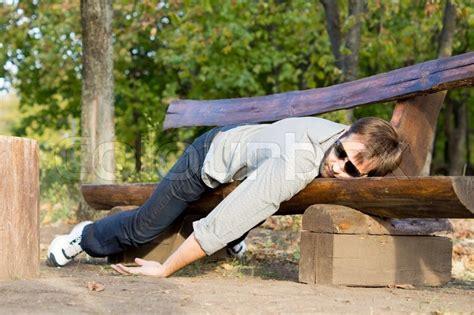 rape bench exhausted man sleeping on bench stock photo colourbox
