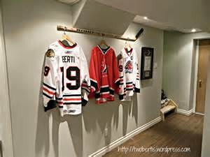 jersey room hanging a hockey stick with jerseys twobertis