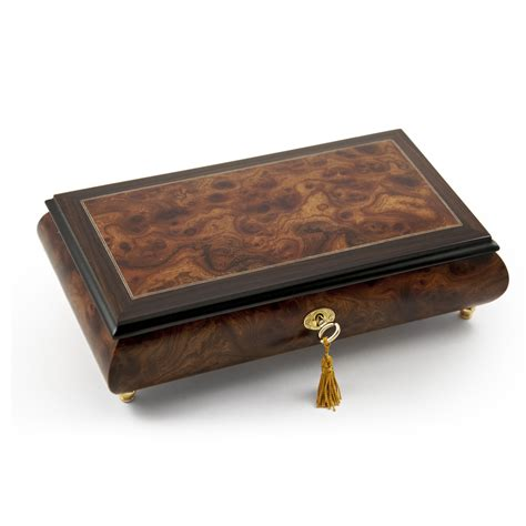 classic style wood tone musical jewelry box with