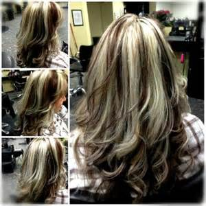 platinum hairstyles with some brown chunky platinum highlights with red brown lowlights
