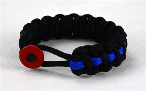 black paracord bracelet with red button front thin blue line