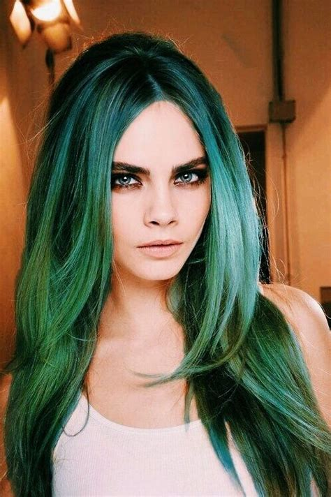 hairstyles done on a mannequin with green hair model cara delevingne green black roots layered long