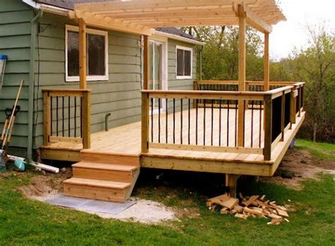 here s a small deck with pergola home exterior deck