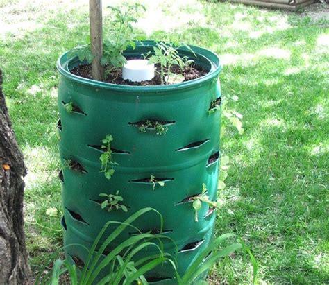 Plastic Barrel Strawberry Planter by Nine Ingenius Ways To Upcycle Those Empty Plastic Barrels