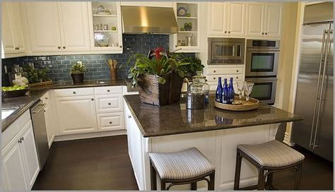 white kitchen cabinets with antique brown granite antiquewhitecabinets in kitchen nara brown caledonia