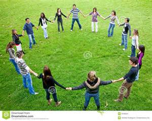 Big friends doing a circle smiling and having fun in the park