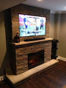 television over fireplace fireplace basement television samsung mantle hearth