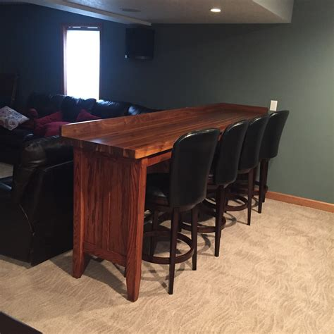 sound bar behind couch bar behind a couch