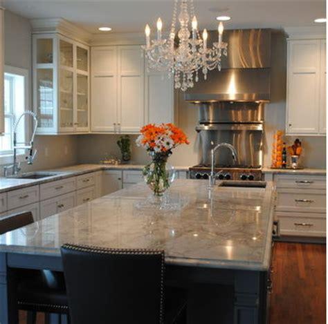 light grey kitchen with dark grey island cabinets omega white cabinets light grey counters dark grey island