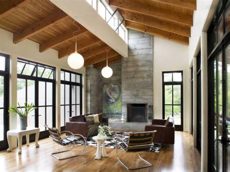raw wood beams  vaulted ceiling  sawtooth skylights