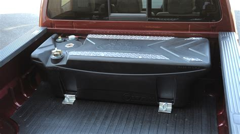 fuel tank for truck bed titan to introduce industry s first polymer in bed