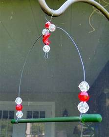 attract hummingbirds with a perch swing birds and blooms