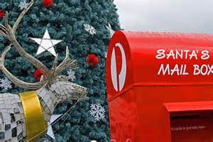 an australia post mail box next to a reindeer and