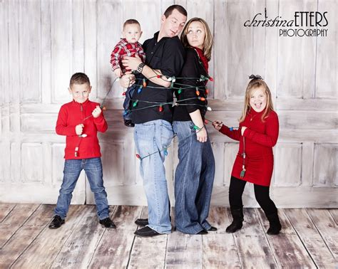 family christmas photo kids wrap parents in lights