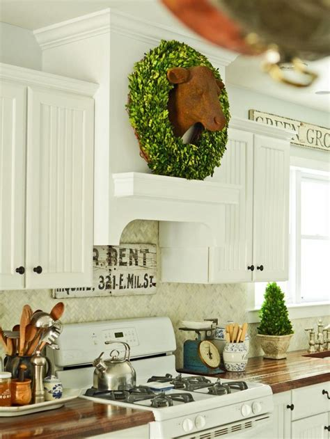 country kitchen range hoods a custom range gives this country kitchen a high end