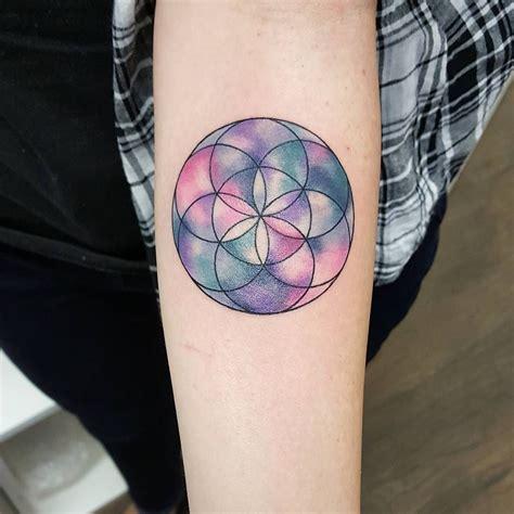 classy tattoo geometric watercolour flower of jemkatattooart