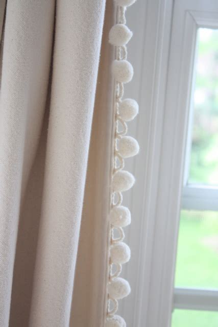 Sewing ball fringe on plain canvas curtains maybe this is what i need to do in our bedroom