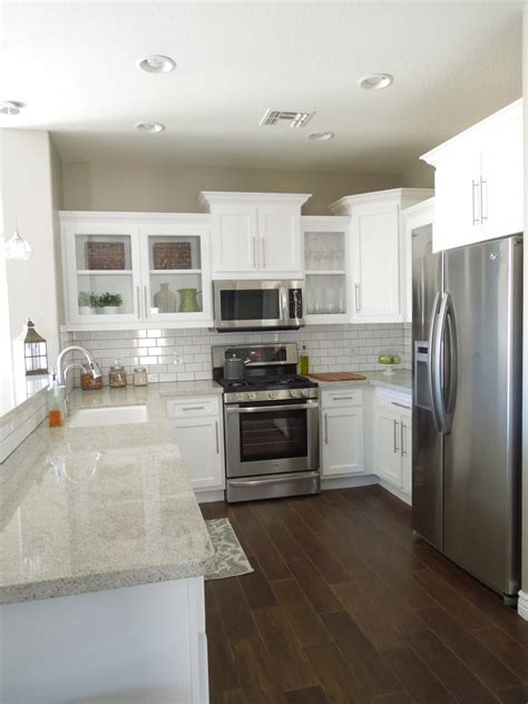 Does Flooring Go Cabinets by Kitchen Progress Wood Tile Floors White Cabinets And