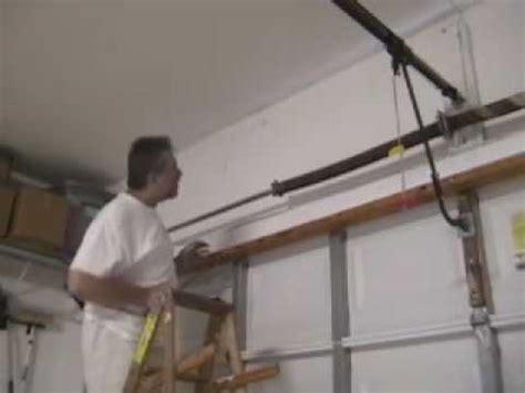 how to remove garage door spring