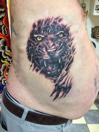 breaking skin tattoo tiger breaking through skin trashcan emporium